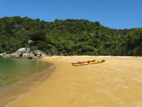 Kayaks on Abel Tasman Beach